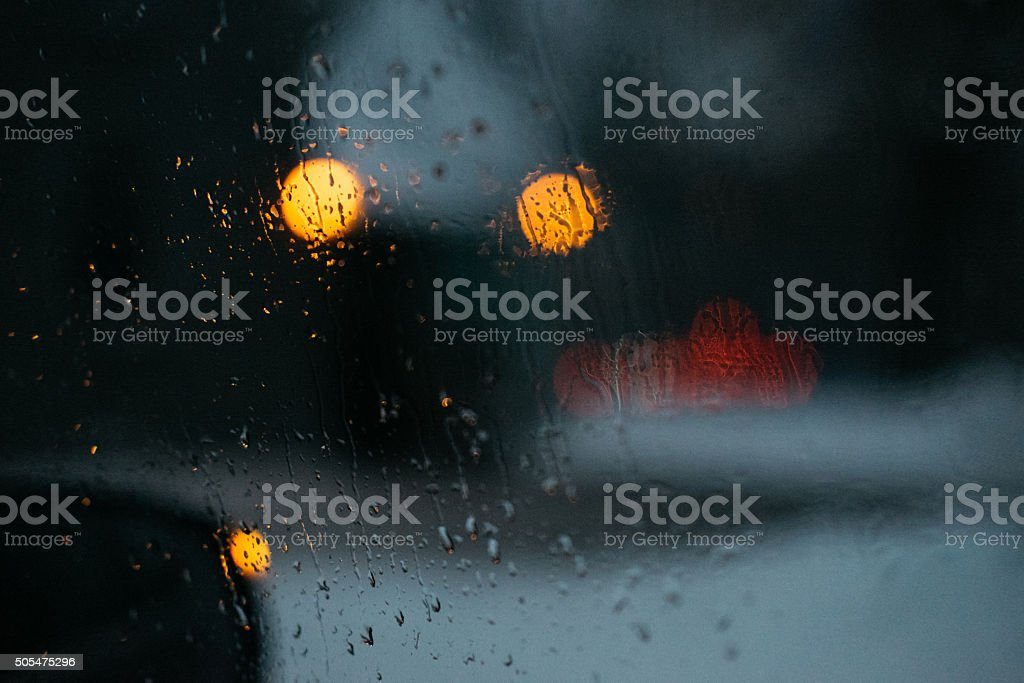 Wet sidewindow closeup in a cold day stock photo