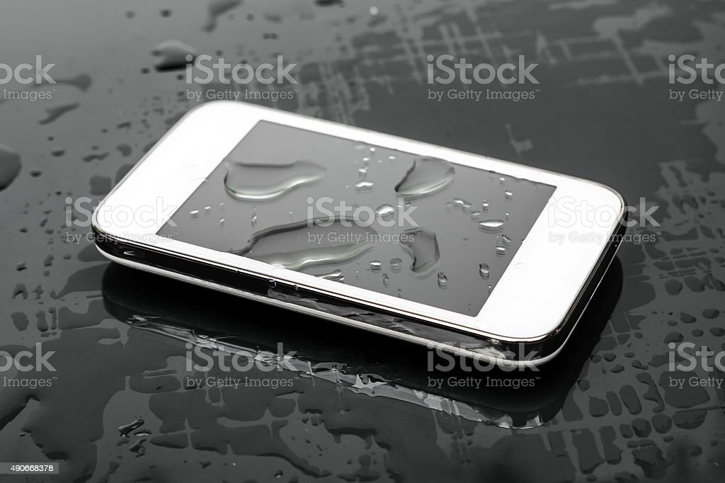 wet smartphone stock photo