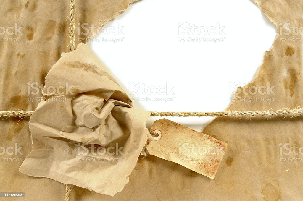 Wet stained parcel with grunge tag stock photo