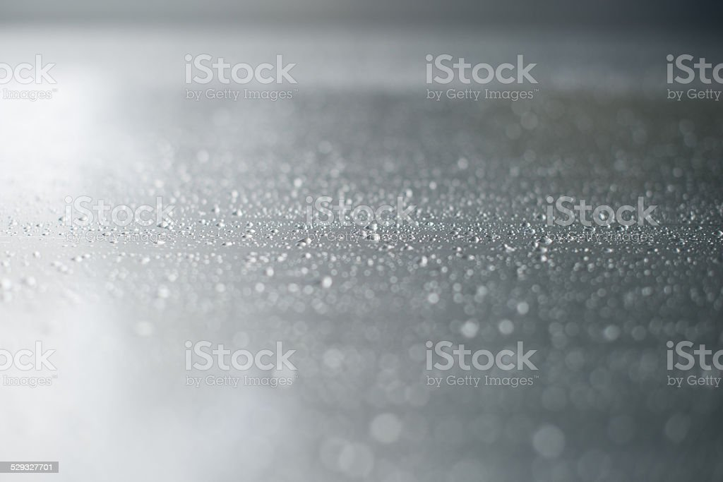 Wet stainless steel background stock photo