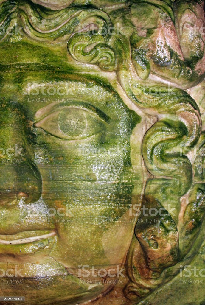 Wet stone Medusa head - base of column in Basilica Cistern, Istanbul, Turkey stock photo