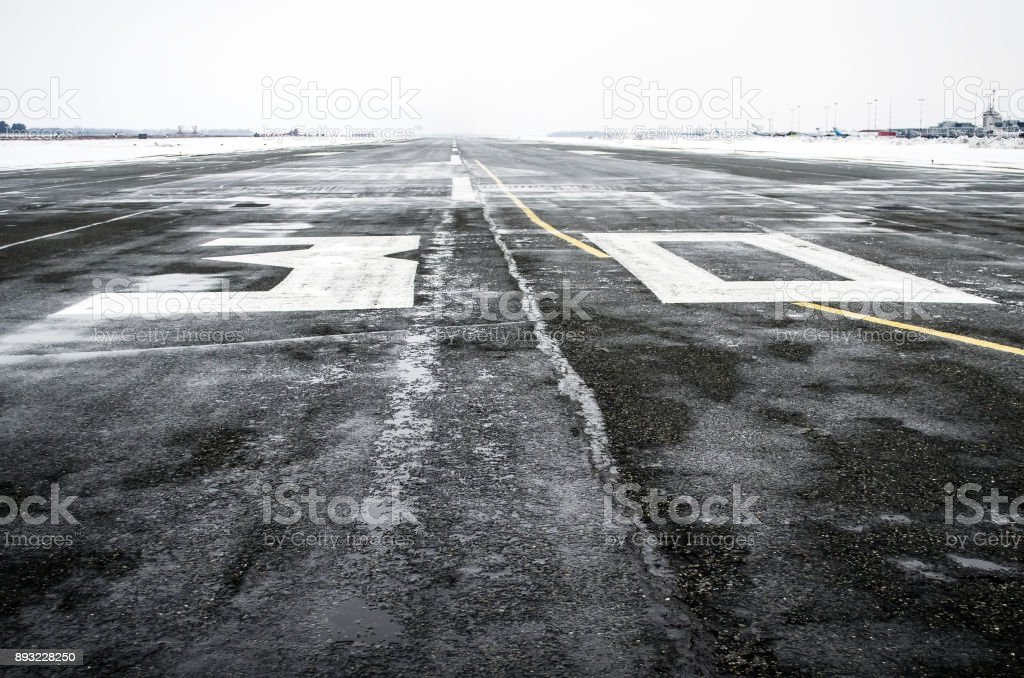 Wet to the airport in cloudy weather in winter. stock photo
