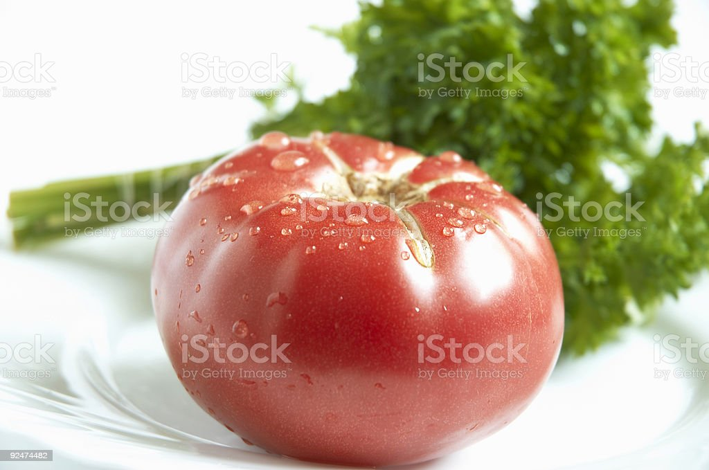wet tomato and greens royalty-free stock photo
