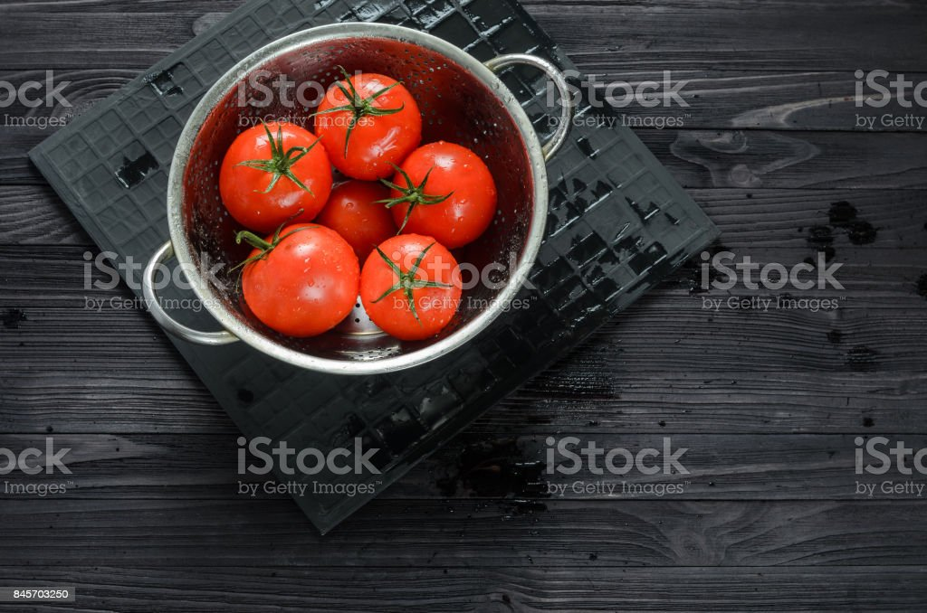 Wet Tomatoes in a Colander After Washing stock photo
