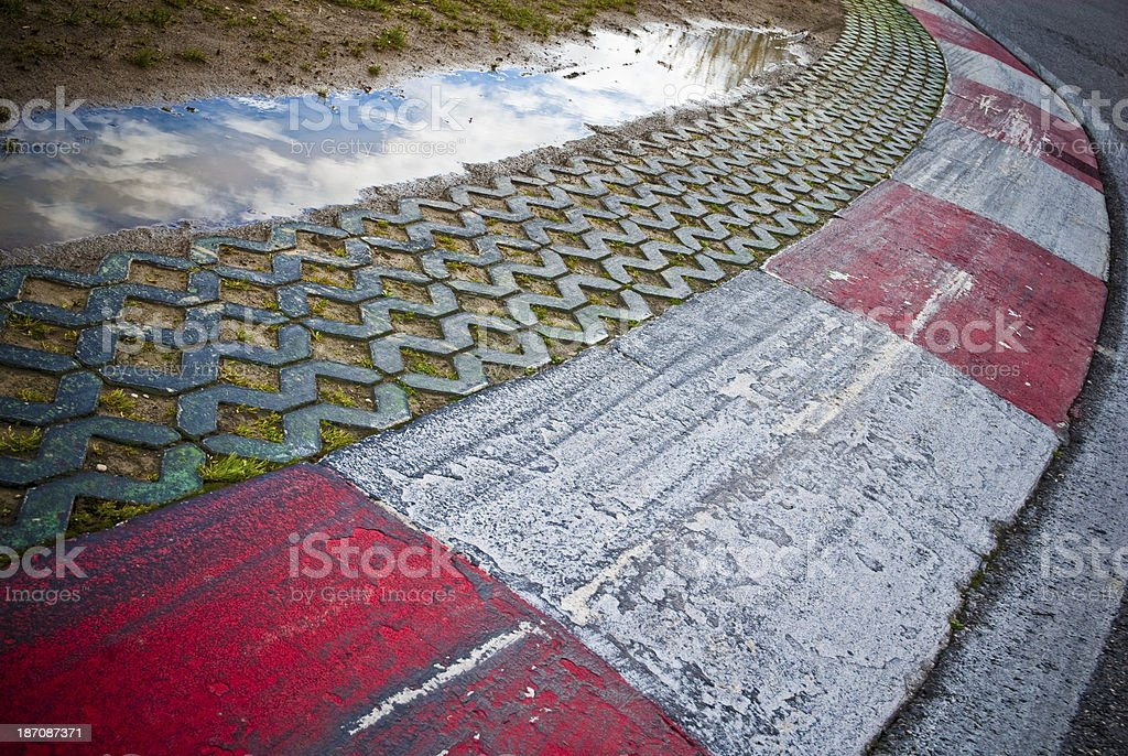 Wet Track Kerb stock photo