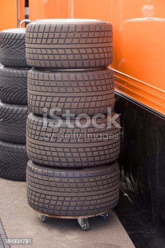 A stack of wet weather racing car tires.