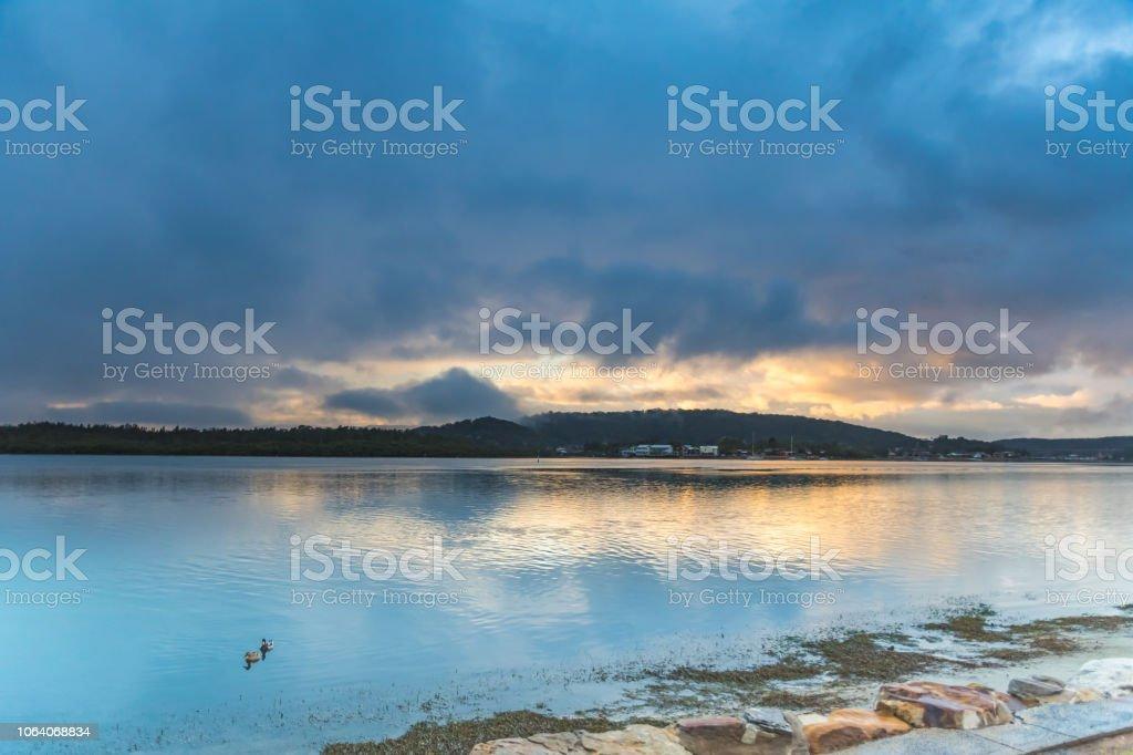 Wet Weather Sunrise on the Bay stock photo