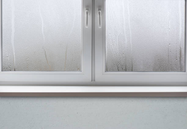 wet window after autumn or winter rain - condensation stock photos and pictures
