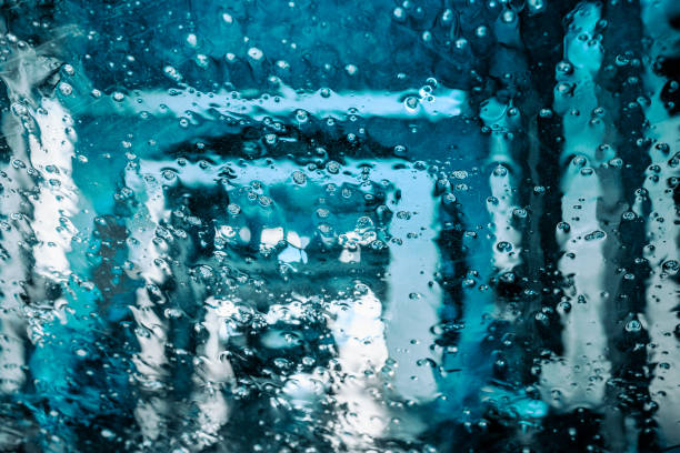 Wet window with water drops in car wash stock photo
