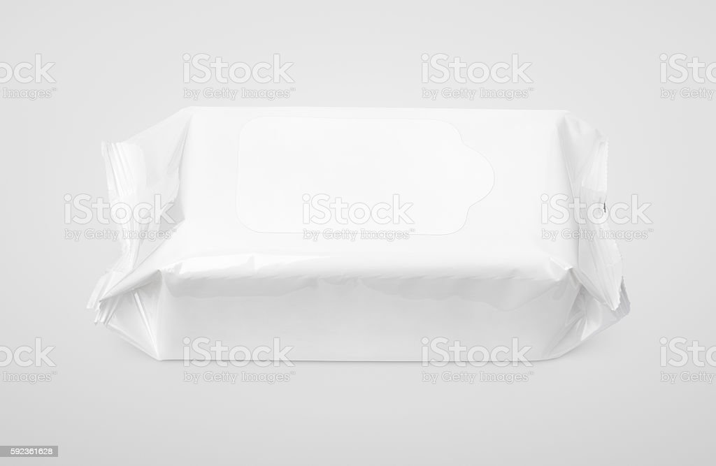 Wet wipes white package with flap on gray stock photo