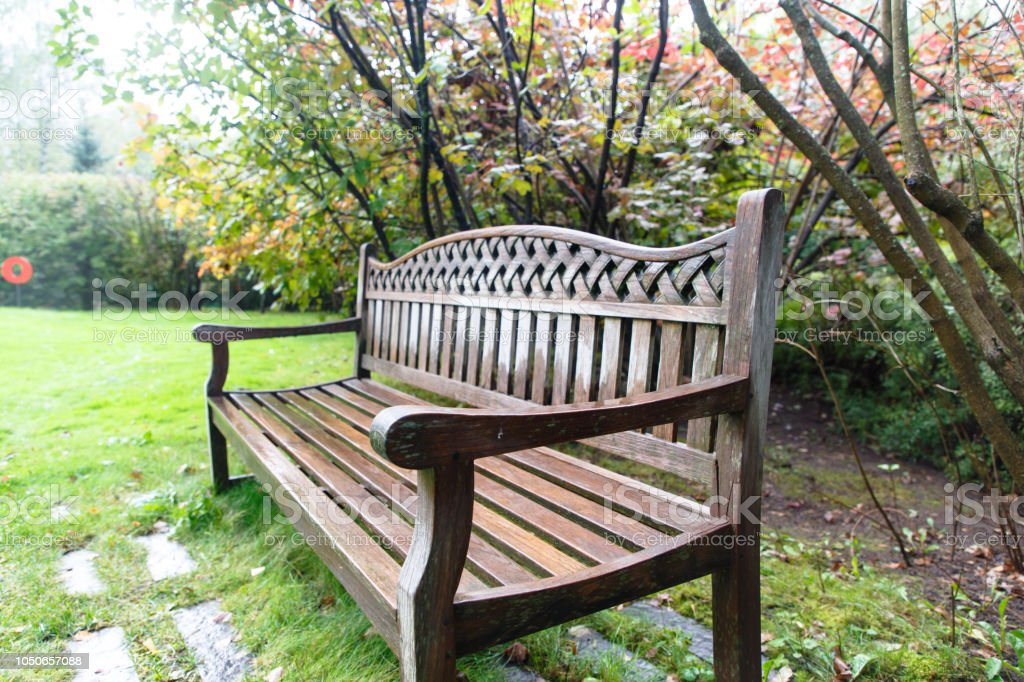 Wondrous A Wet Wooden Bench Stands In The Garden Stock Photo Gmtry Best Dining Table And Chair Ideas Images Gmtryco