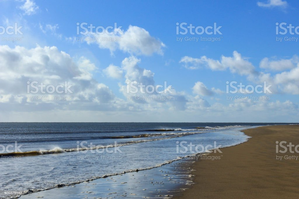 Wets Sands Left by Retreating Tide stock photo