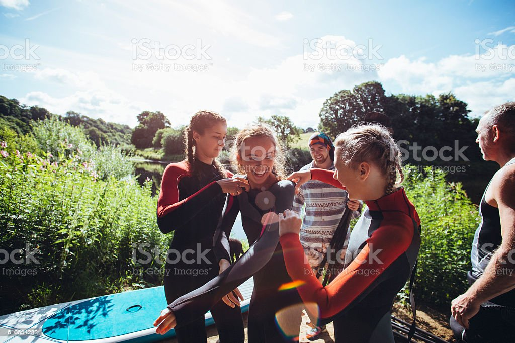 Wetsuit Struggles! stock photo