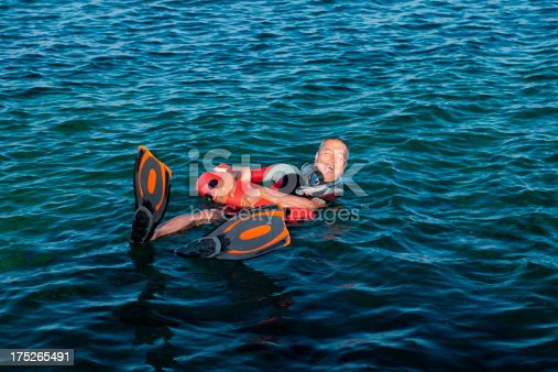 istock Wetsuit wore man yelling for assistance 175265491
