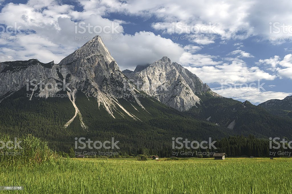 wetterstein mountains in austria with green meadow royalty-free stock photo