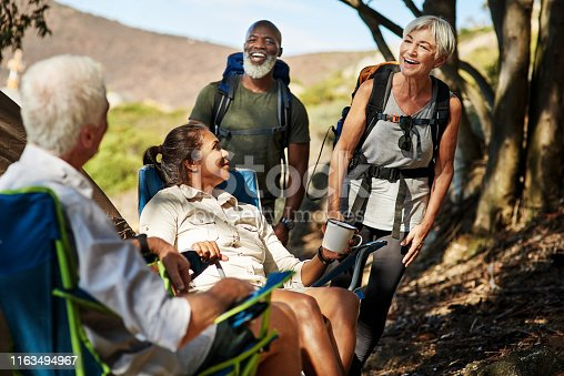 Shot of a group of senior people enjoying themselves while hiking out in the mountains