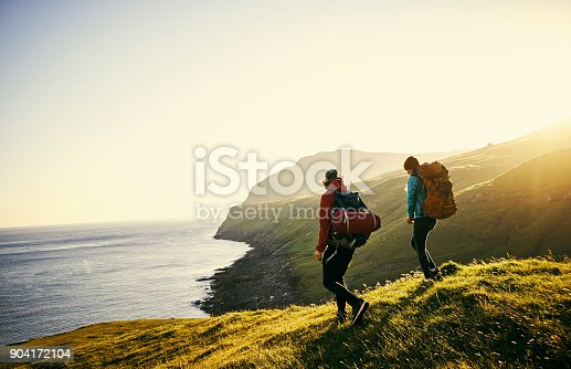 Shot of a young couple hiking through the mountains