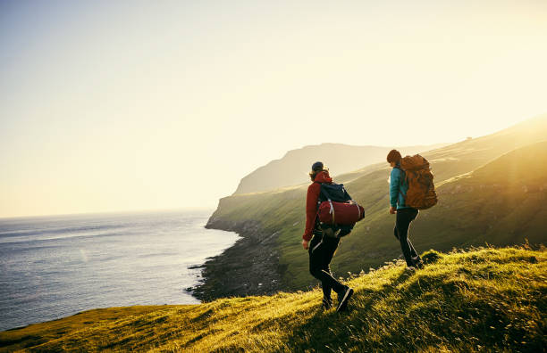 We've made it all this way, I am proud Shot of a young couple hiking through the mountains travel stock pictures, royalty-free photos & images