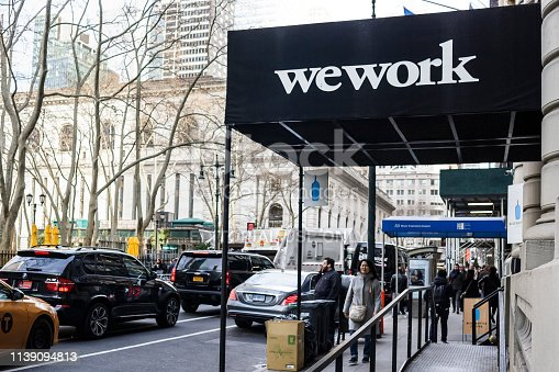 New York, New York, USA - March 28, 2019: The Wework location on 40th street near 6th Avenue.  People can be seen walking and standing on the street.