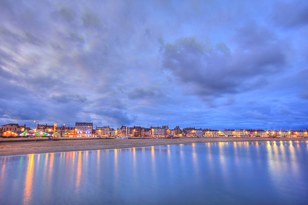 weymouth beach sunset - weymouth stock photos and pictures