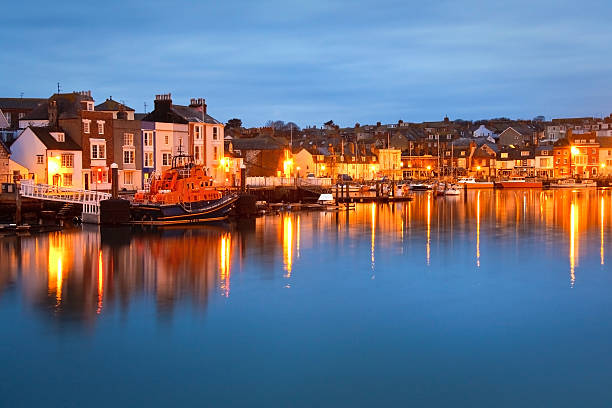 weymouth harbor in dorset. - weymouth stock photos and pictures
