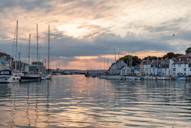 weymouth harbour at dawn - weymouth stock photos and pictures