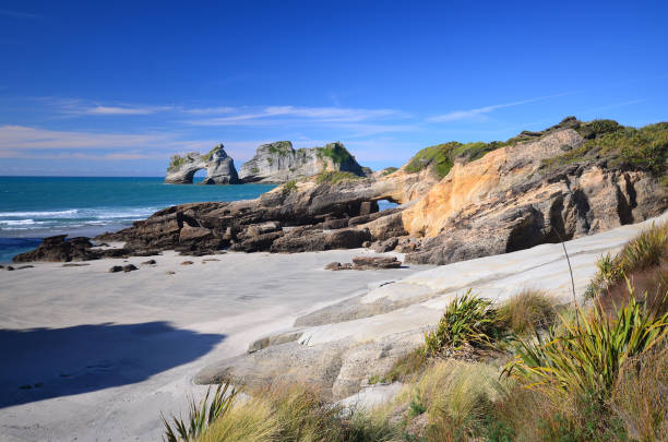Wharariki bech - Archway islands stock photo