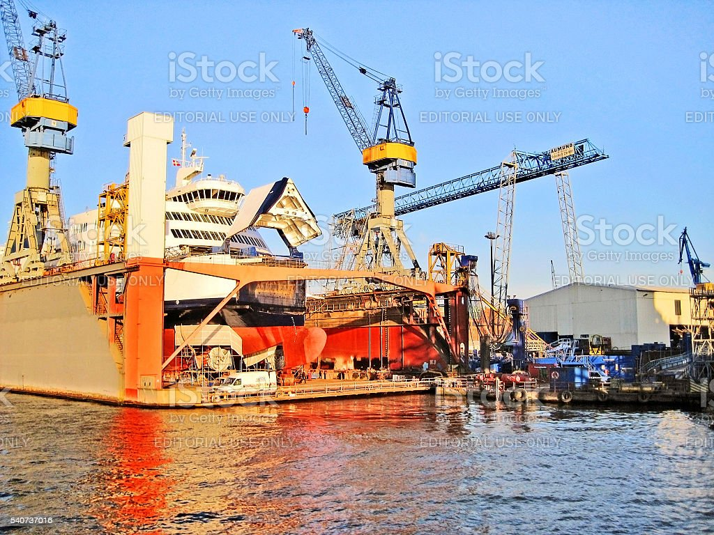 Hamburg harbor - view of wharf with cranes - ship repair. View from...