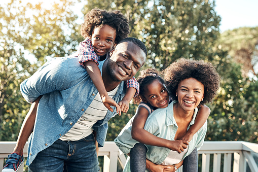 istock What a nice day out carrying the children 902827440