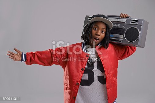 Studio shot of a young boy dressed in hip hop attire