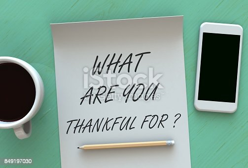 1050881964 istock photo What Are You Thankful For, message on paper, smart phone and coffee on table, 3D rendering 849197030