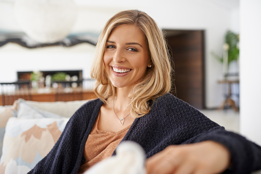 Portrait of an attractive young woman relaxing on the sofa at home