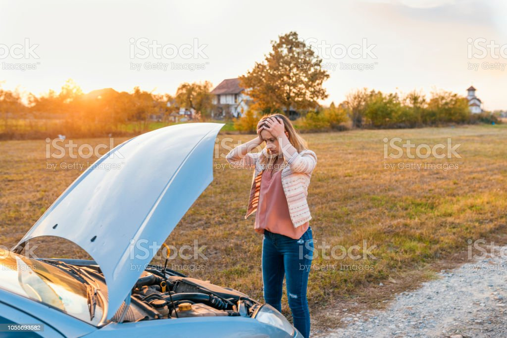Photo of Stressed Young Caucasian Woman with Car Defect. Engine...