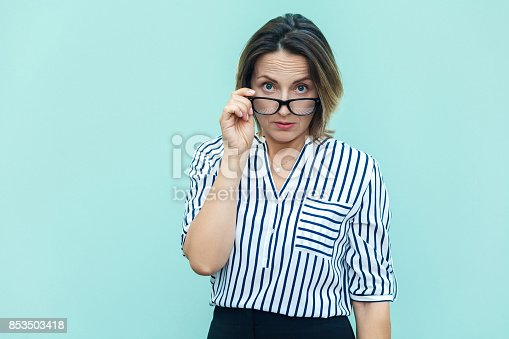 istock What did you say? Seriosly blonde busines woman and boss with glass looking at camera. 853503418
