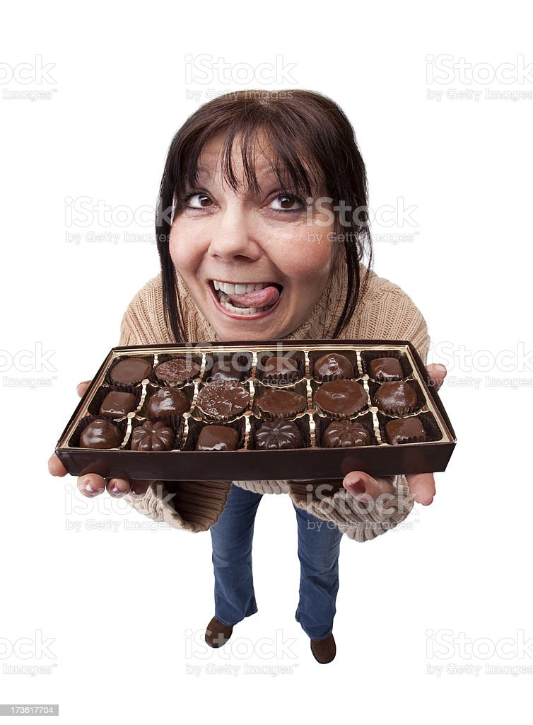 What Diet?! A fisheye image of a woman about to give up on her diet and eat chocolates. 50-54 Years Stock Photo