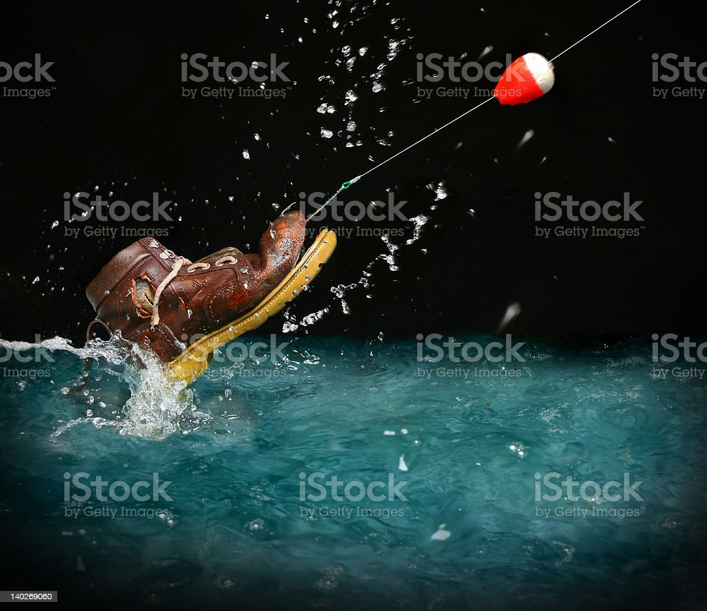 What disappointment!  a shoe instead of  fish stock photo