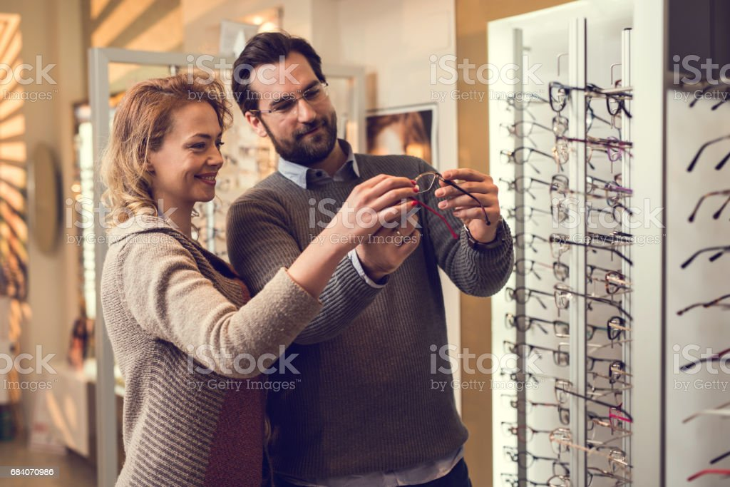 What do you think about these eyeglasses honey? stock photo