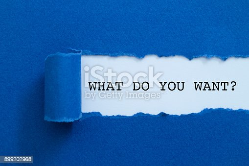 What do you want? written under torn paper.