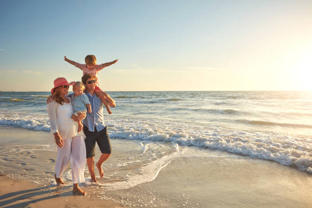 what great weather for a walk on the beach - family vacation stock photos and pictures