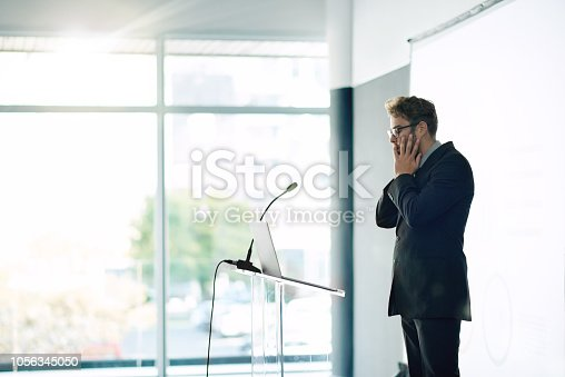 Shot of a young businessman looking nervous while rehearsing a speech at a conference