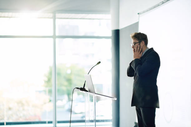 What have I gotten myself into? Shot of a young businessman looking nervous while rehearsing a speech at a conference speech stock pictures, royalty-free photos & images