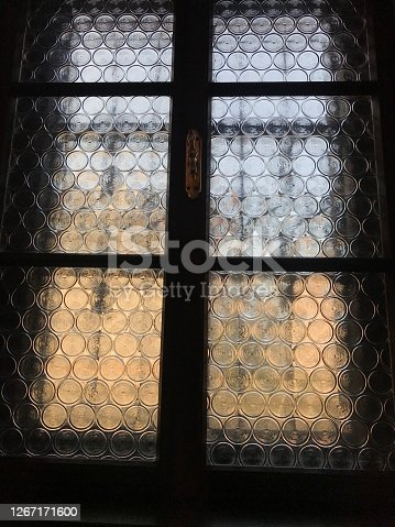 Looking at window from a dark room and curious what is there behind the window.