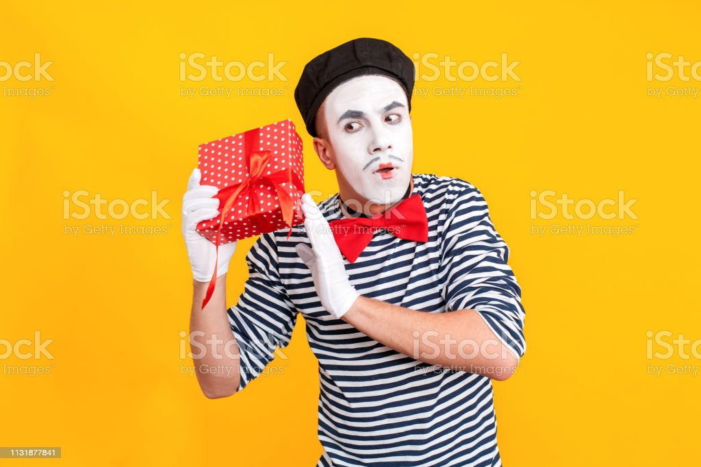 What is inside box Puzzled mime man holding red box. Emotions and...