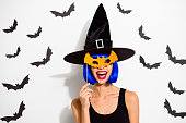 istock What is so terrible here its funny ! Close up portrait of winsome, lovable, fascinating lady look at camera make wide shine toothy smile, hold orange paper mask near face isolated on white background 1048221796