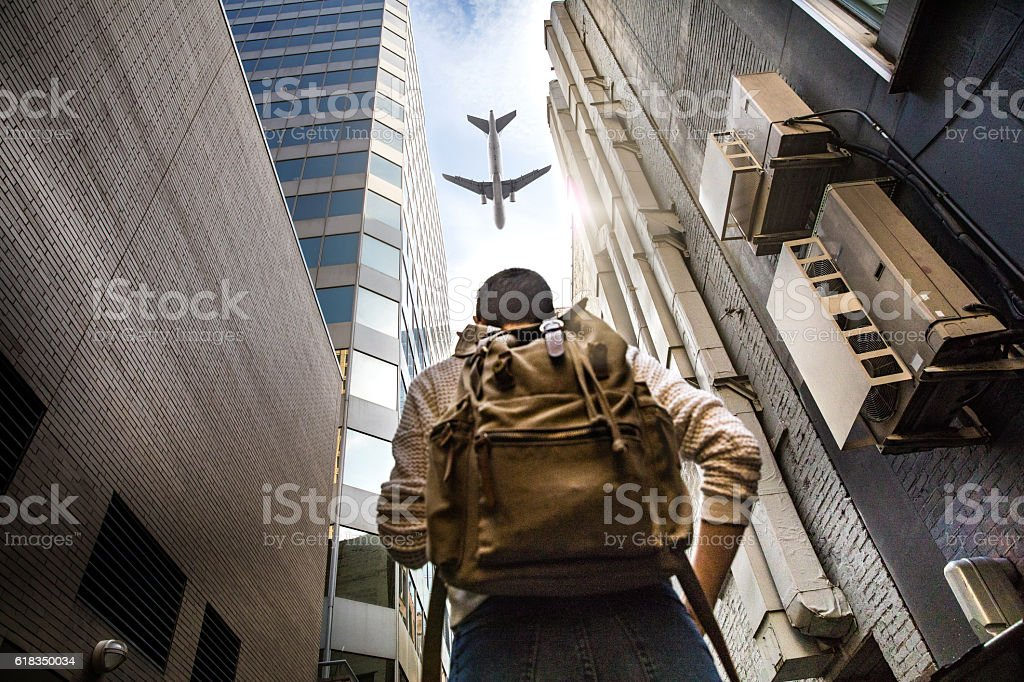 What is your next travel destination? Woman looking a plane stock photo