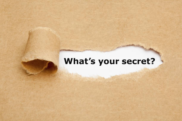 What Is Your Secret Torn Paper Concept stock photo