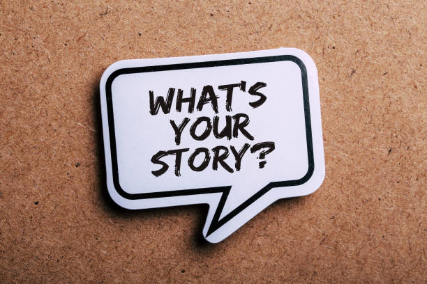What Is Your Story Speech Bubble Isolated On Brown paper Background stock photo