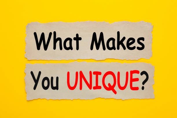 What Makes You Unique Concept What Makes You UNIQUE written on old torn paper on yellow background. protruding stock pictures, royalty-free photos & images