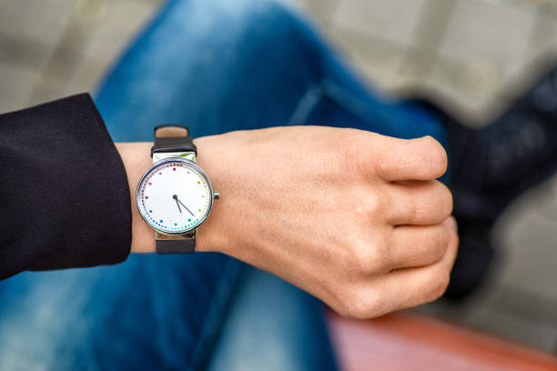 What time is it. Silver wristwatch on hand of woman. stock photo