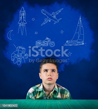 Portrait of a boy with a cloud and various pictures over his head, dreaming about his future.